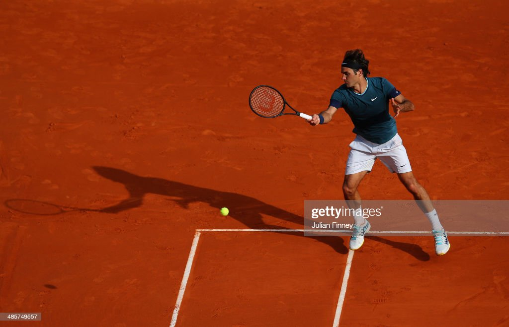 <a gi-track='captionPersonalityLinkClicked' href=/galleries/search?phrase=Roger+Federer&family=editorial&specificpeople=157480 ng-click='$event.stopPropagation()'>Roger Federer</a> of Switzerland in action against Stanislas Wawrinka of Switzerland in the final during day eight of the ATP Monte Carlo Rolex Masters Tennis at Monte-Carlo Sporting Club on April 20, 2014 in Monte-Carlo, Monaco.