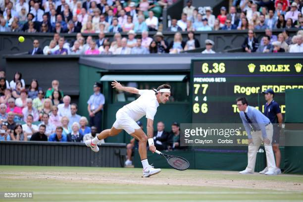 Roger Federer of Switzerland in action against Thomas Berdych of the Czech Republic in the Gentlemen's Singles Semifinal of the Wimbledon Lawn Tennis...