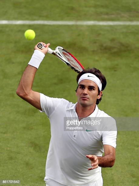 Roger Federer of Switzerland in action during his men's singles first round match against Albert Ramos of Spain on Day One of the Wimbledon Lawn...
