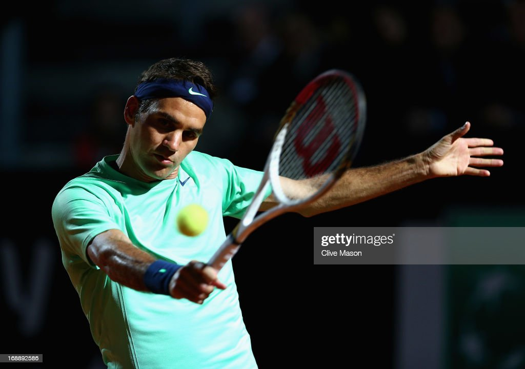 Roger Federer of Switzerland in action during his third round match against Gilles Simon of France on day five of the Internazionali BNL d'Italia 2013 at the Foro Italico Tennis Centre on May 16, 2013 in Rome, Italy.