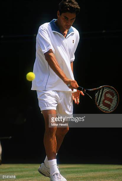 Roger Federer of Switzerland in action during his win over Irakli Labadze of Georgia in the Boys Singles Final during The Championships at the All...