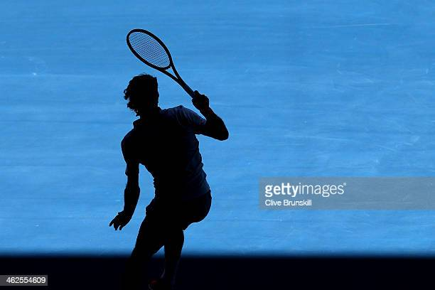 Roger Federer of Switzerland in action in his first round match against James Duckworth of Australia during day two of the 2014 Australian Open at...
