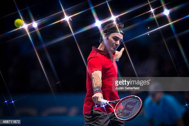 Roger Federer of Switzerland in action in his match against Milos Raonic of Canada in the round robin during day one of the Barclays ATP World Tour...