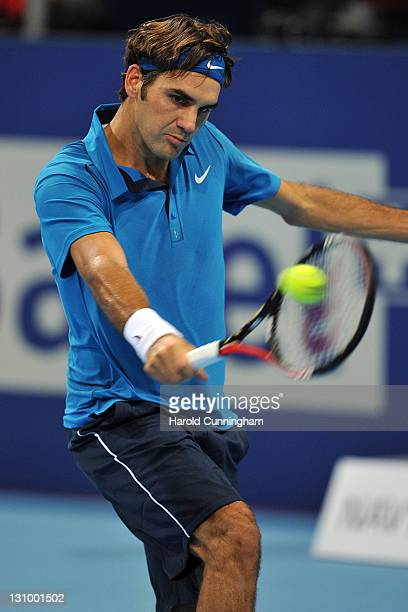 Roger Federer of Switzerland in action in his match against Potito Starace of Italy during day one of the Swiss Indoors at St Jakobshalle on October...