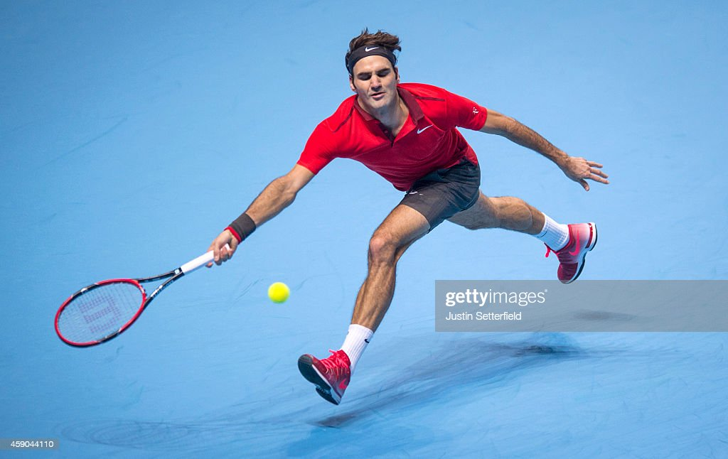 Roger Federer of Switzerland in action in the singles semifinal match against Stan Wawrinka of Switzerland on day seven of the Barclays ATP World...