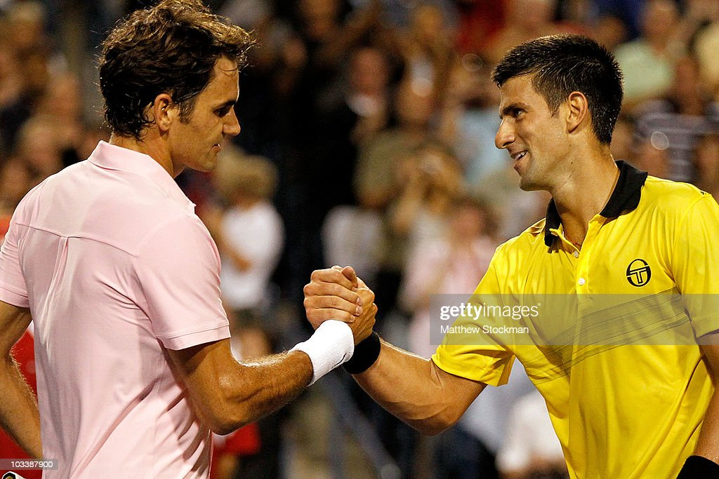 <a gi-track='captionPersonalityLinkClicked' href=/galleries/search?phrase=Roger+Federer&family=editorial&specificpeople=157480 ng-click='$event.stopPropagation()'>Roger Federer</a> of Switzerland is congratulated at the net by <a gi-track='captionPersonalityLinkClicked' href=/galleries/search?phrase=Novak+Djokovic&family=editorial&specificpeople=588315 ng-click='$event.stopPropagation()'>Novak Djokovic</a> of Serbia after their match during the semifinals of the Rogers Cup at the Rexall Centre on August 14, 2010 in Toronto, Canada.