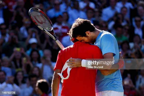 Roger Federer of Switzerland is congratulated by Juan Martin Del Potro of Argentina after his 46 76 1917 win in the Semifinal of Men's Singles Tennis...