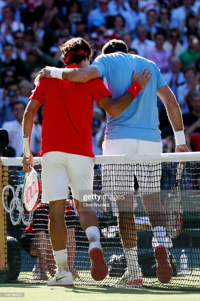 <a gi-track='captionPersonalityLinkClicked' href=/galleries/search?phrase=Roger+Federer&family=editorial&specificpeople=157480 ng-click='$event.stopPropagation()'>Roger Federer</a> of Switzerland is congratulated by <a gi-track='captionPersonalityLinkClicked' href=/galleries/search?phrase=Juan+Martin+Del+Potro&family=editorial&specificpeople=606583 ng-click='$event.stopPropagation()'>Juan Martin Del Potro</a> of Argentina after his 4-6, 7-6, 19-17 win in the Semifinal of Men's Singles Tennis on Day 7 of the London 2012 Olympic Games at Wimbledon on August 3, 2012 in London, England.