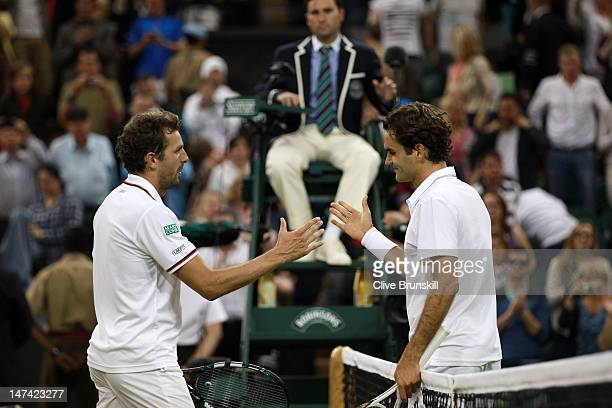 Roger Federer of Switzerland is congratulated by Julien Benneteau of France after their Gentlemen's Singles third round match on day five of the...