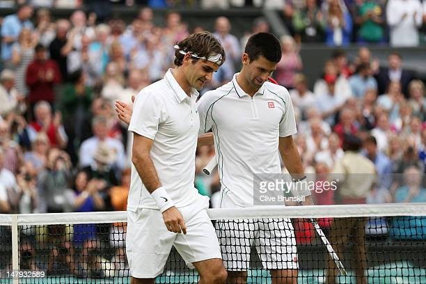 Roger Federer of Switzerland is congratulated by Novak Djokovic of Serbia after his Gentlemen's Singles semi final match on day eleven of the...