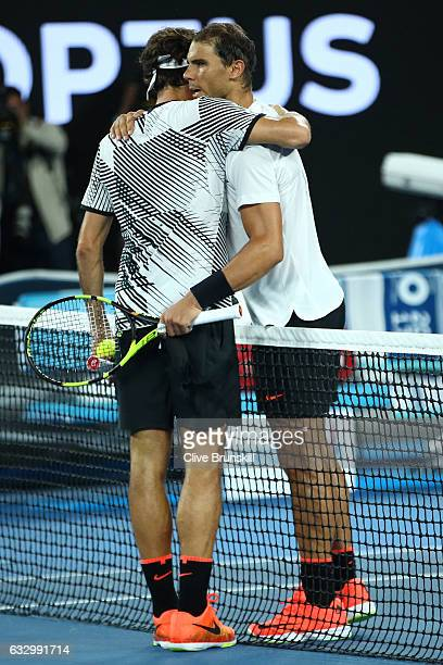 Roger Federer of Switzerland is congratulated by Rafael Nadal of Spain after winning their Men's Final match against on day 14 of the 2017 Australian...