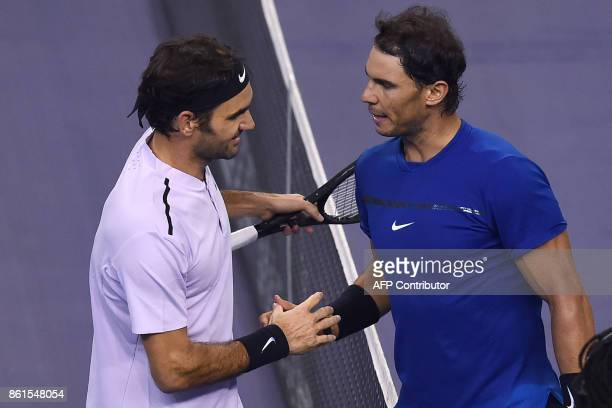 Roger Federer of Switzerland is congratulated by Rafael Nadal of Spain after their men's singles final match at the Shanghai Masters tennis...
