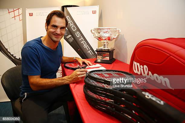 Roger Federer of Switzerland is presented with a commemorative 18 Grand Slam Tennis Racket after winning the 2017 Mens Australian Open Championship...