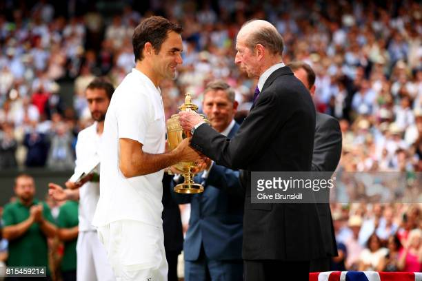 Roger Federer of Switzerland is presented with the trophy by The Duke of Kent after the Gentlemen's Singles final against Marin Cilic of Croatia on...