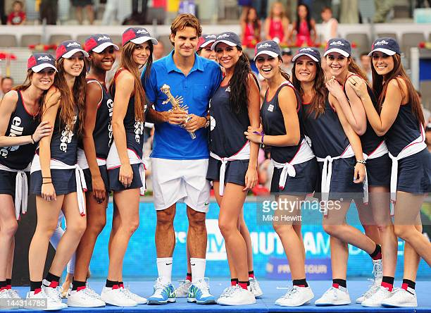 Roger Federer of Switzerland is surrounded by ball girls after his victory over Tomas Berdych of Czech Republic in the Men's Single Final on Day Nine...
