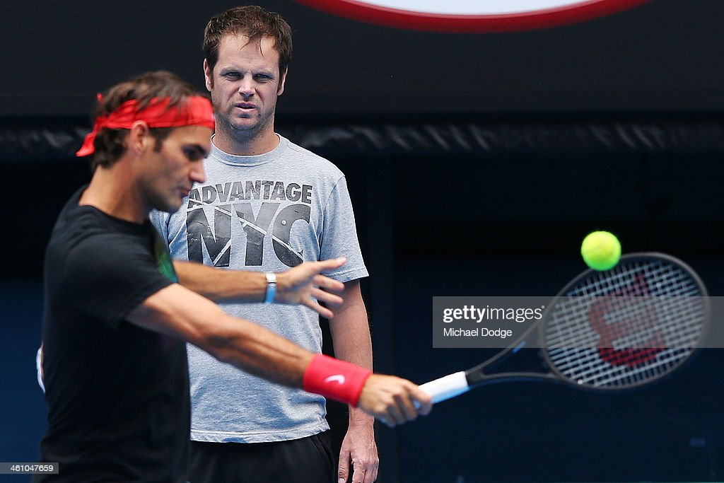 <a gi-track='captionPersonalityLinkClicked' href=/galleries/search?phrase=Roger+Federer&family=editorial&specificpeople=157480 ng-click='$event.stopPropagation()'>Roger Federer</a> of Switzerland is watched by coach Severin Luthi during a practice session ahead of the 2014 Australian Open at Melbourne Park on January 7, 2014 in Melbourne, Australia.