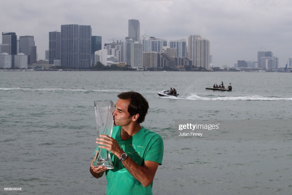 Roger Federer of Switzerland kisses the trophy in front of the Miami skyline after defeating Rafael Nadal of Spain in the final at The Rusty Pelican on April 2, 2017 in Key Biscayne, Florida.