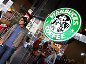 Roger Federer of Switzerland leaves a Starbucks Coffee in between morning talk show apparences on September 13 2004 in New York City Federer defeated...