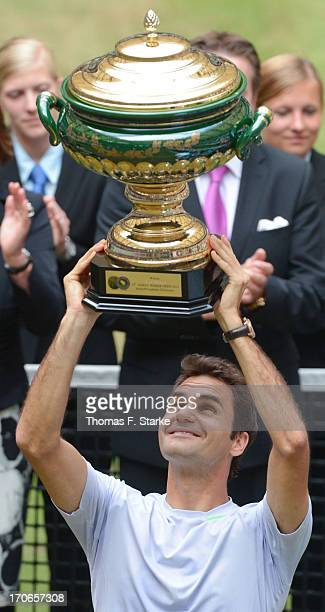 Roger Federer of Switzerland lift the winners cup after the final match against Mikhail Youzhny of Russia during the final day of the Gerry Weber...