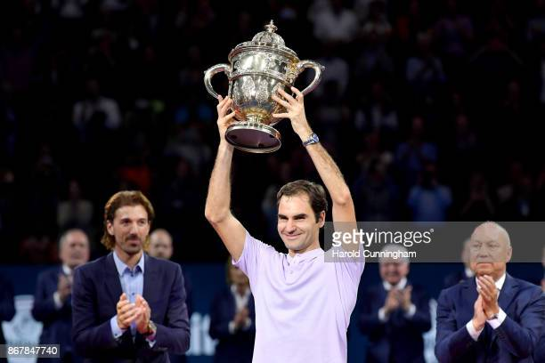 Roger Federer of Switzerland lifts the trophy as he celebrates his victory during the final match of the Swiss Indoors ATP 500 tennis tournament...