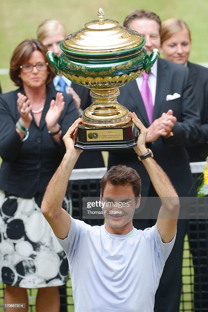 Roger Federer of Switzerland lifts the winners cup after the final match against Mikhail Youzhny of Russia during the final day of the Gerry Weber...
