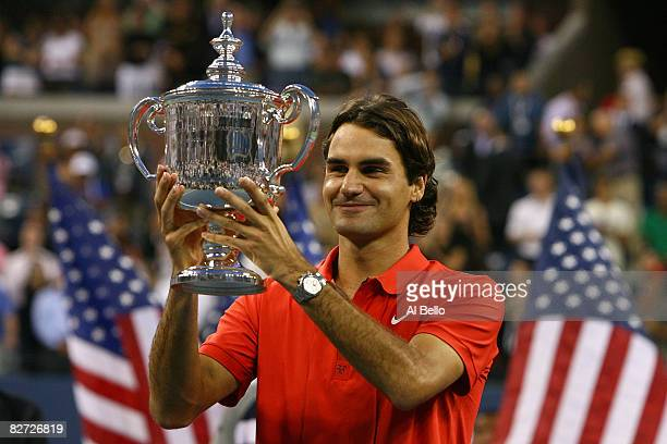 Roger Federer of Switzerland looks at the trophy after defeating Andy Murray of the United Kingdom to win the 2008 US Open Men's Championship Match...