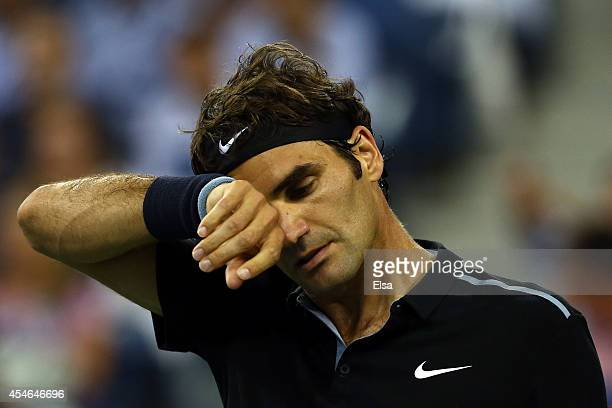 Roger Federer of Switzerland looks on against Gael Monfils of France during their men's singles quarterfinal match on Day Eleven of the 2014 US Open...