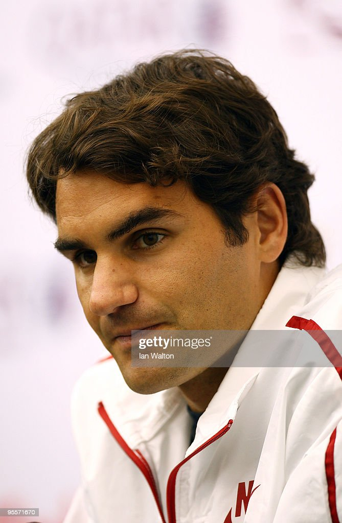 Roger Federer of Switzerland looks on during a press conference at the ATP Qatar Exxon Mobil Open at the Khalifa International Tennis and Squash...