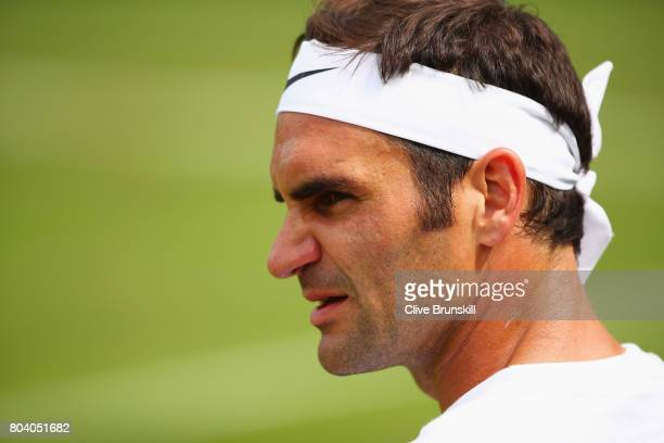 Roger Federer of Switzerland looks on during practice ahead of Wimbledon Lawn Tennis Championships at the All England Lawn Tennis and Croquet Club on...