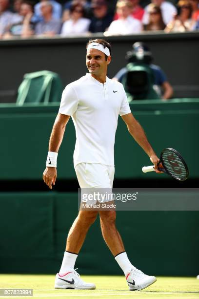 Roger Federer of Switzerland looks on during the Gentlemen's Singles first round match against Alexandr Dolgopolov of Ukraine on day two of the...