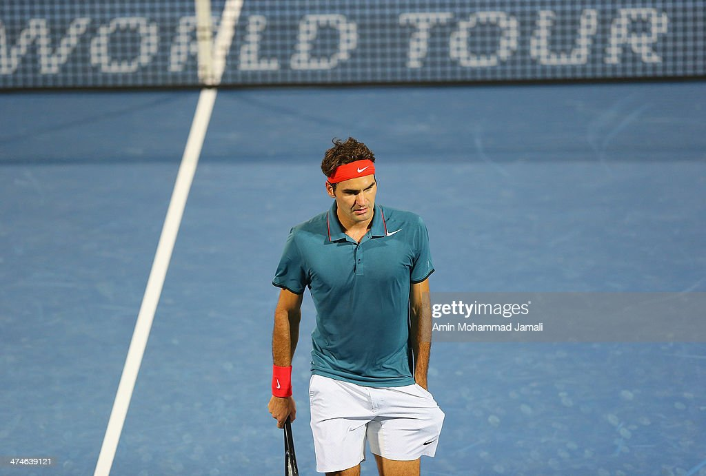 Roger Federer of Switzerland looks on during the match against Benjamin Becker of Germany during their first round match of the Dubai Duty Free Tennis ATP Championships in Dubai on February 24, 2014 in Dubai, United Arab Emirates.