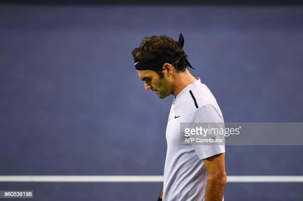 Roger Federer of Switzerland looks on during the men's singles against Alexandr Dolgopolov of Ukraine at the Shanghai Masters tennis tournament in...