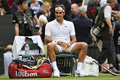 Roger Federer of Switzerland looks on during the Men's Singles first round match against Giodo Pella of Argentina on day one of the Wimbledon Lawn...
