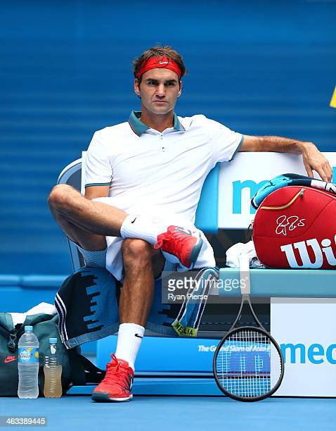 Roger Federer of Switzerland looks on in his third round match against Teymuraz Gabashvili of Russia during day six of the 2014 Australian Open at...