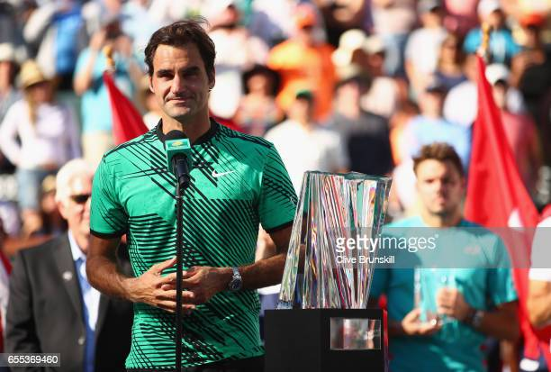 Roger Federer of Switzerland makes his winners speach after his straight sets victory against Stanislas Wawrinka of Switzerland in the mens final...