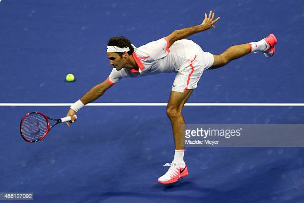 Roger Federer of Switzerland misses a shot against Novak Djokovic of Serbia during their Men's Singles Final match on Day Fourteen of the 2015 US...