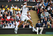 Roger Federer of Switzerland misses the ball during the Men's Singles first round match against Giodo Pella of Argentina on day one of the Wimbledon...