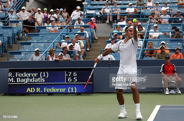Roger Federer of Switzerland on a match point serve against Marcos Baghdatis of Cyprus during the Western Southern Financial Group Masters on August...
