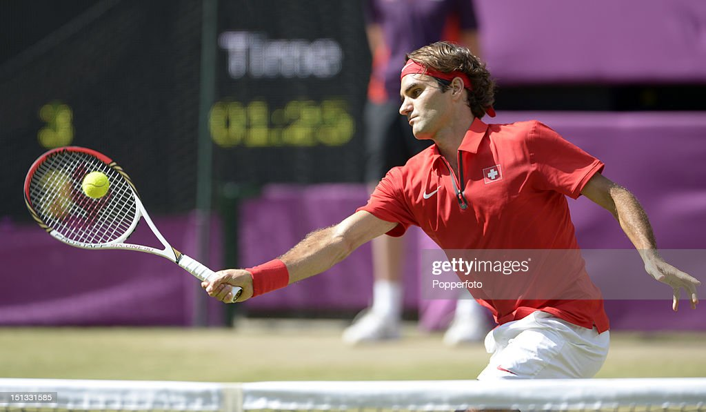 Roger Federer of Switzerland playing against Andy Murray of Great Britain during the Men's Singles Tennis Gold Medal Match on Day 9 of the London 2012 Olympic Games at the All England Lawn Tennis and Croquet Club on August 5, 2012 in London, England.