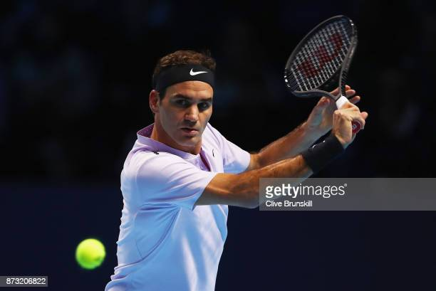 Roger Federer of Switzerland plays a backhand against Jack Sock of the United States during the Nitto ATP World Tour Finals at O2 Arena on November...