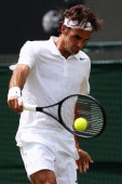 Roger Federer of Switzerland plays a backhand during his Gentlemen's Singles first round match against Paolo Lorenzi of Italy on day two of the...