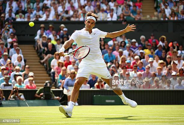 Roger Federer of Switzerland plays a backhand during his Gentlemens Singles Second Round match against Sam Querry of the United States during day...
