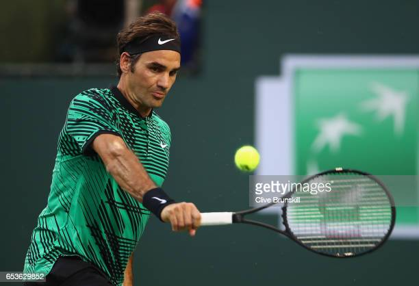 Roger Federer of Switzerland plays a backhand during his straight sets victory against Rafael Nadal of Spain in their fourth round match during day...