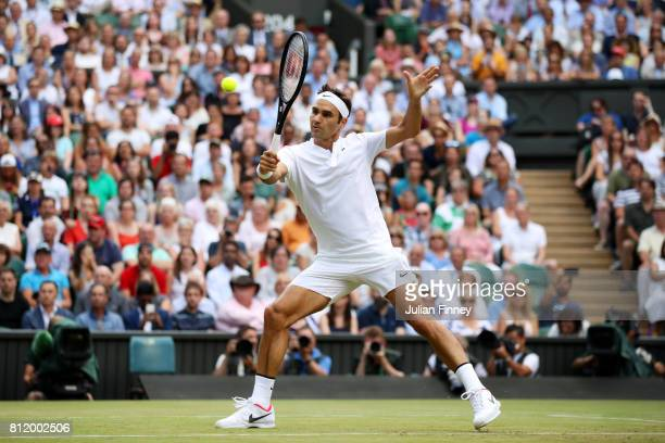 Roger Federer of Switzerland plays a backhand during the Gentlemen's Singles fourth round match against Grigor Dimitrov of Bulgaria on day seven of...