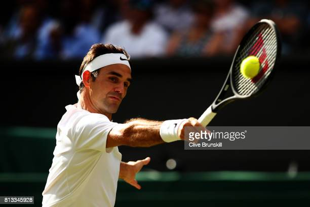Roger Federer of Switzerland plays a backhand during the Gentlemen's Singles quarter final match against Milos Raonic of Canada on day nine of the...