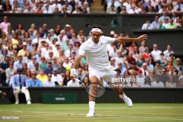 Roger Federer of Switzerland plays a backhand during the Gentlemen's Singles final against Marin Cilic of Croatia on day thirteen of the Wimbledon...