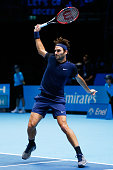 Roger Federer of Switzerland plays a backhand during the men's singles final against Novak Djokovic of Serbia on day eight of the Barclays ATP World...