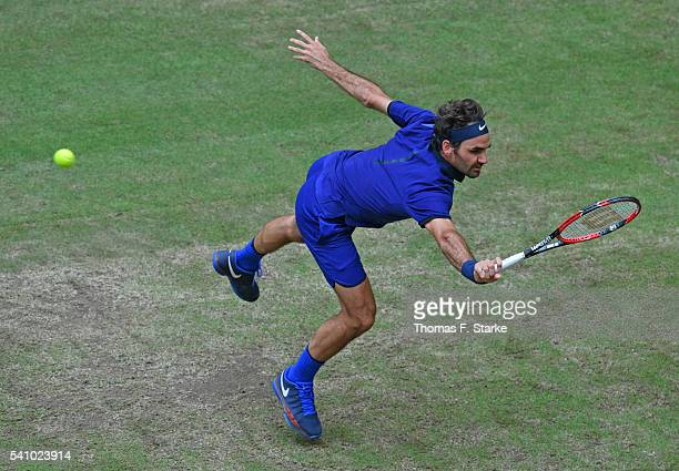 Roger Federer of Switzerland plays a backhand in his half final match against Alexander Zverev of Germany during day six of the Gerry Weber Open at...