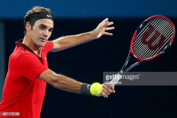 Roger Federer of Switzerland plays a backhand in his match against John Millman of Australia during day five of the 2015 Brisbane International at...