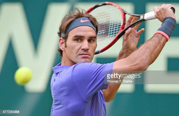 Roger Federer of Switzerland plays a backhand in his match against Philipp Kohlschreiber of Germany during day one of the Gerry Weber Open at Gerry...
